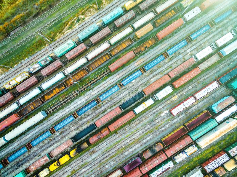 Aerial shoot of railway tracks with lots of wagons. Aerial shoot of railway tracks with lots of colorful train wagons royalty free stock images
