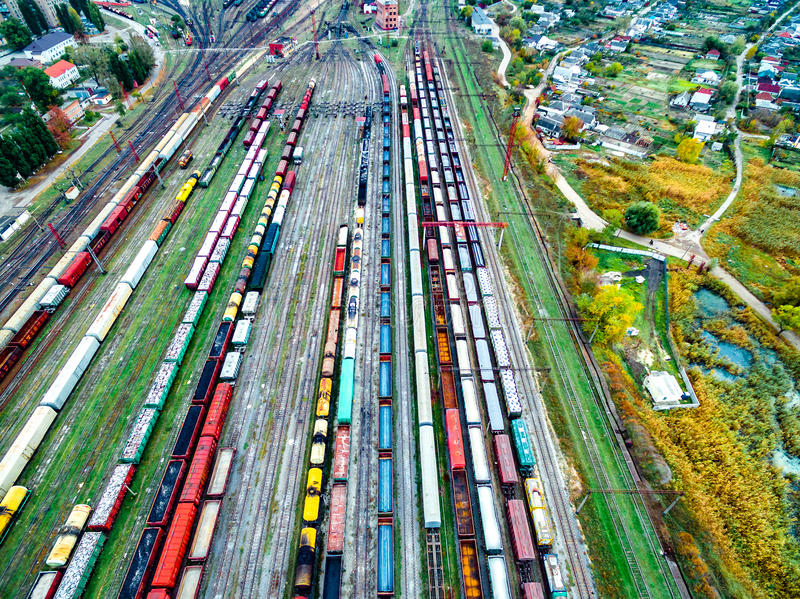 Aerial shoot of railway tracks with lots of wagons. Aerial shoot of railway tracks with lots of colorful train wagons royalty free stock photography