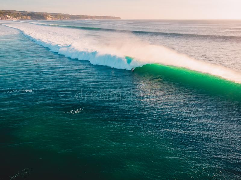 Aerial shooting of big green waves at sunset. Biggest ocean waves in Bali royalty free stock photography