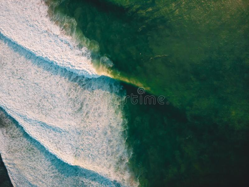 Aerial shooting of big stormy waves at sunset. Background with ocean wave royalty free stock photos