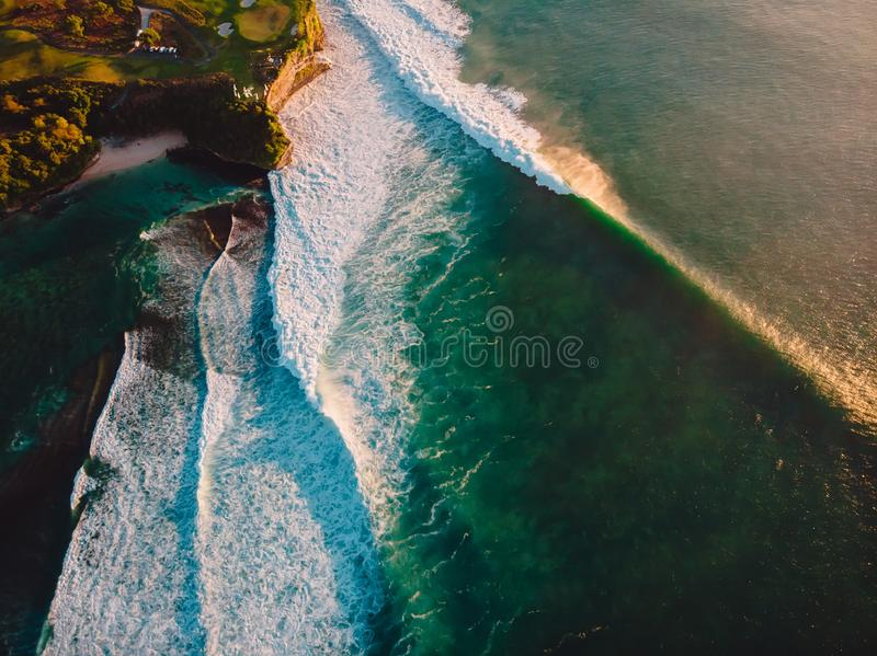 Aerial shooting of storm waves at sunset. Ocean waves in Bali stock image