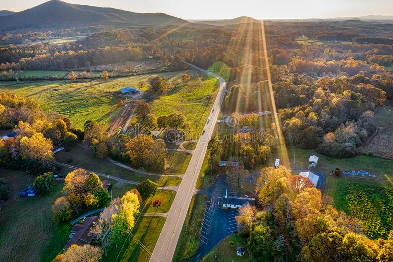 Aerial shot of backlit road in Georgia Mountains during the sunset in the Fall royalty free stock photo