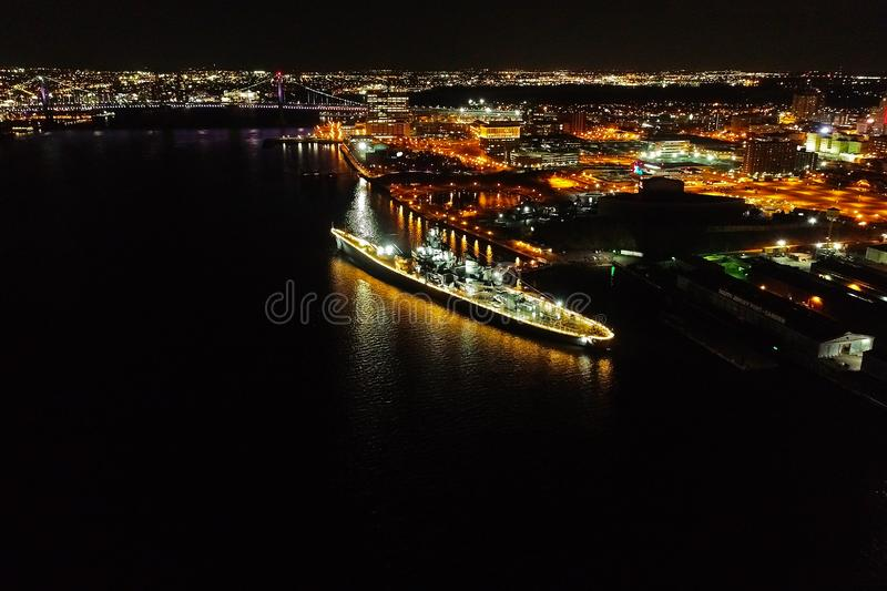 Aerial Shot of the Battleship New Jersey in the Delaware River at Camden New Jersey at Night.  royalty free stock image