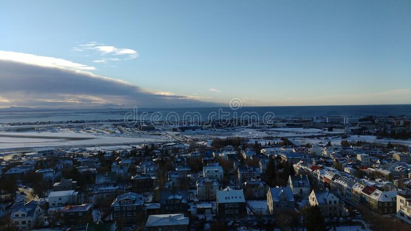 Aerial shot of the beautiful city of Reykjavik, Iceland during winter with a cloudy horizon. An aerial shot of the beautiful city of Reykjavik, Iceland during stock images
