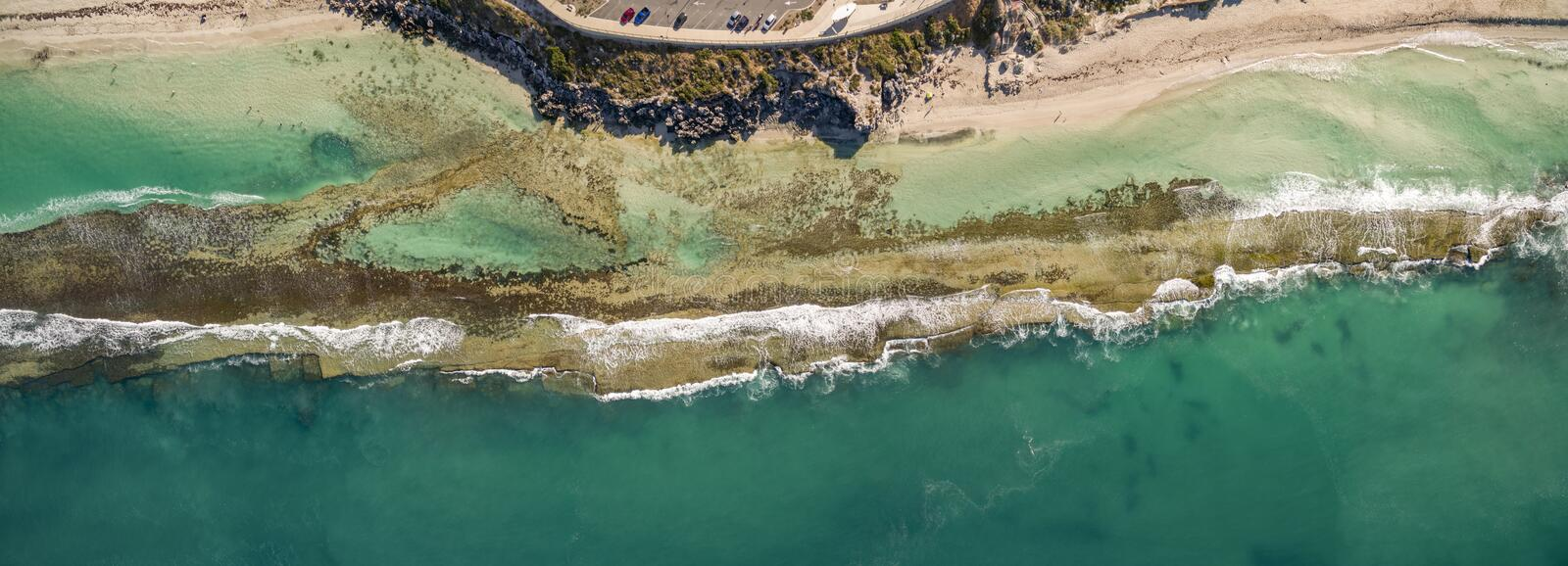 Aerial shot of the beautiful ocean waves meeting the beach stock images