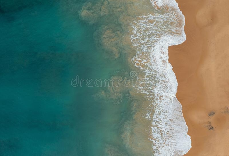 Aerial shot of the beautiful ocean waves meeting the sands on the beach royalty free stock photos