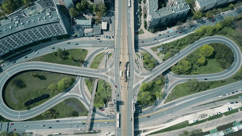 Aerial shot of big urban road junction on a sunny day, top down view. Aerial shot of big urban road junction on a sunny day stock photography