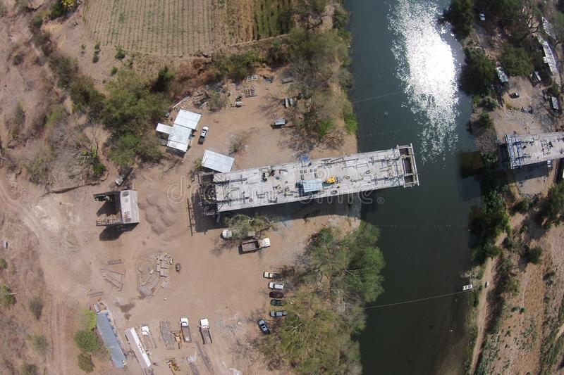 Aerial shot of construction process of a bridge over a river stock photo