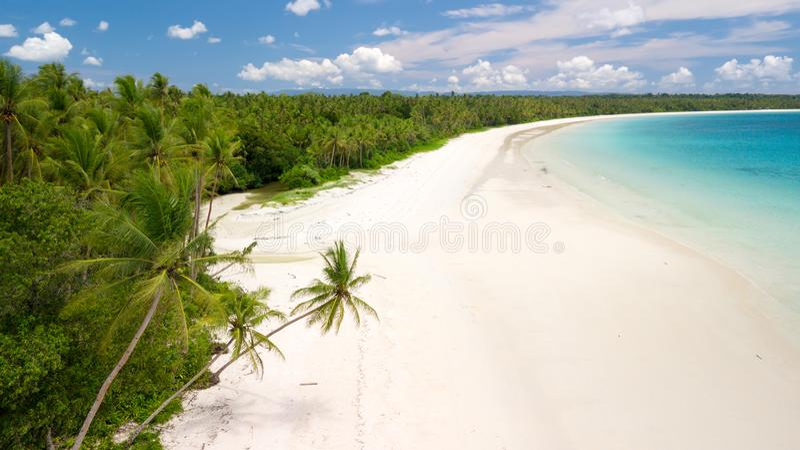 Aerial shot of deserted tropical beach. Aerial shot of the deserted tropical Ohoidertawun beach with vast area of white sand, Kei Kecil island, Maluku, Indonesia royalty free stock photos