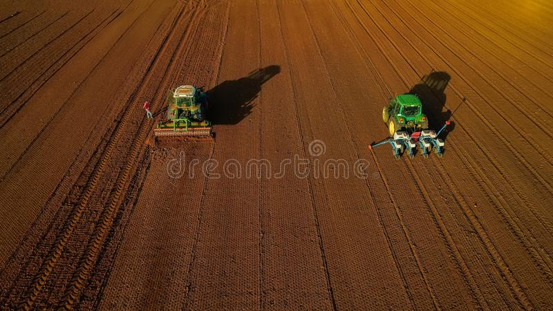 Aerial shot of Farmer with a tractor on the agricultural field royalty free stock image