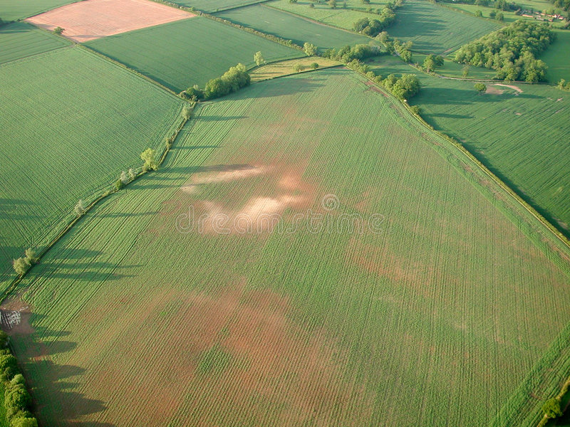 Aerial shot of fields with barren patches stock photos