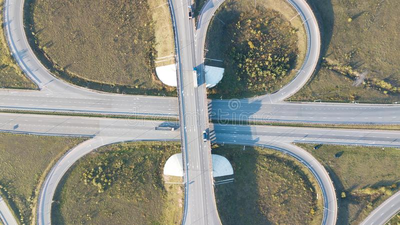 Aerial shot of highway junction with cars top view.  royalty free stock photo