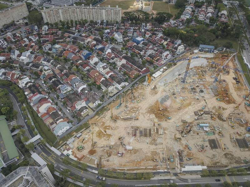 Aerial shot of houses and construction site. Aerial shot of private houses adjacent to a construction site near Marymount, Singapore. Image captured with a DJI royalty free stock images