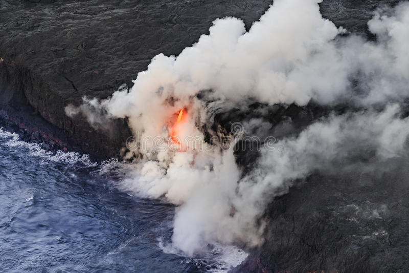 Aerial shot of Kīlauea lava tube entering the sea. Off Hawaii stock images