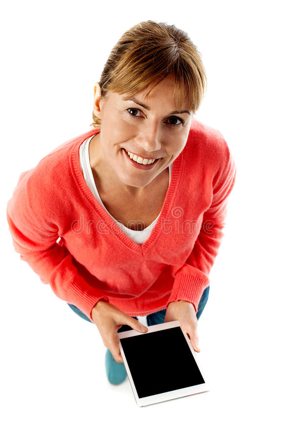 Aerial Shot Of A Lady Using Tablet Pc Stock Photography
