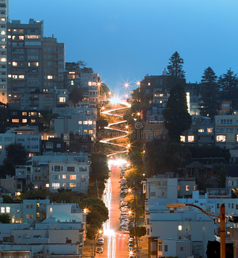 Aerial shot of the Lombard Street near buildings during nighttime in San Francisco, California. An aerial shot of the Lombard Street near buildings during royalty free stock photo