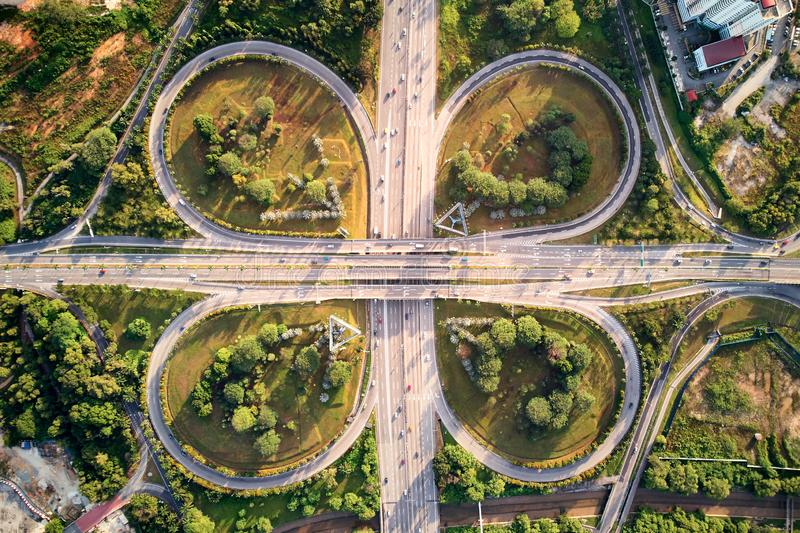 Aerial shot of a motorway with cloverleaf pattern. An aerial shot of a motorway with cloverleaf overpass. The motorway is filled with traffic but not congested royalty free stock photos