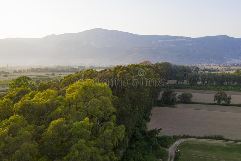 Aerial shot of mountain scene with trees in the middle royalty free stock image