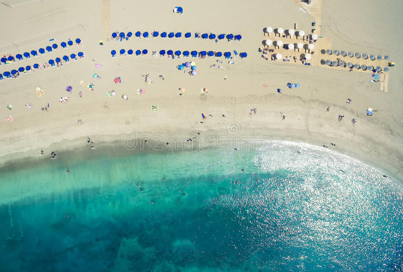 Aerial shot of people spending their holidays o. Aerial shot (top view point) of people spending their holidays on beach and ocean in Adeje Playa de las Americas stock image