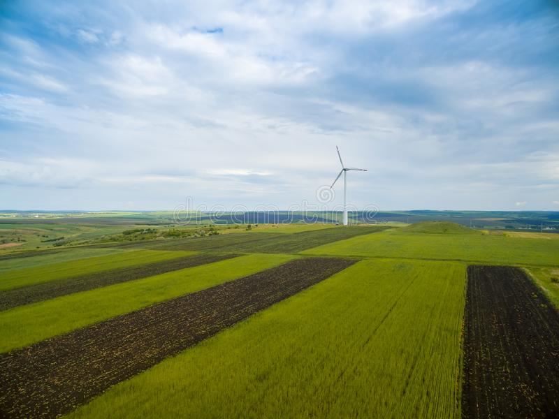 Aerial shot of a single wind turbine on rural agricultural fields stock photo