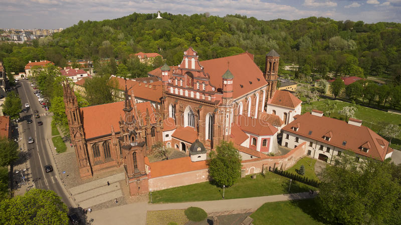 Aerial shot of St. Anna's Church in Vilnius, Lithuania. Summer time. AERIAL. Beautiful sunny aerial shot of St. Anna's Church in Vilnius, Lithuania. Summer time royalty free stock images
