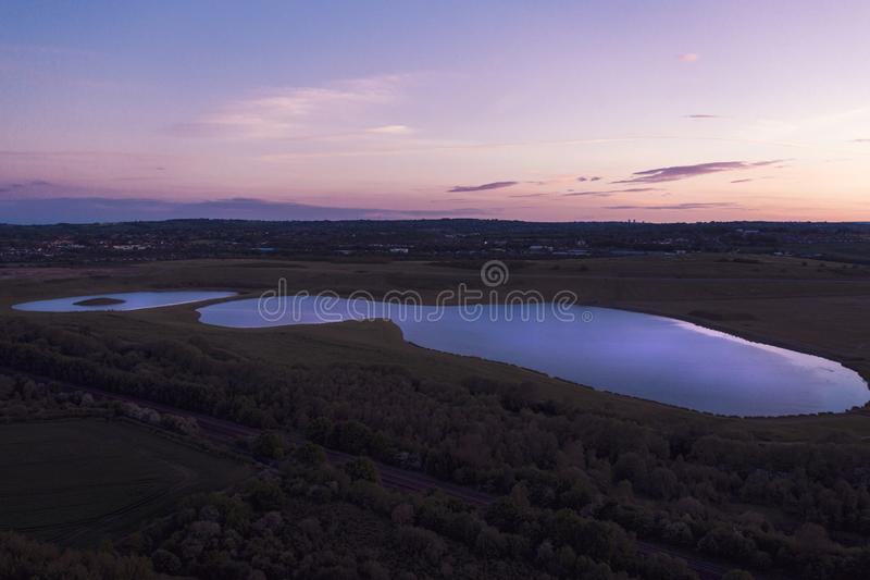 Aerial shot of Sunset over Waverley Lake, Rotherham, South Yorkshire. A large lake that`s surrounded by Catcliffe, Treeton, Waverley inbetween Rotherham and stock image