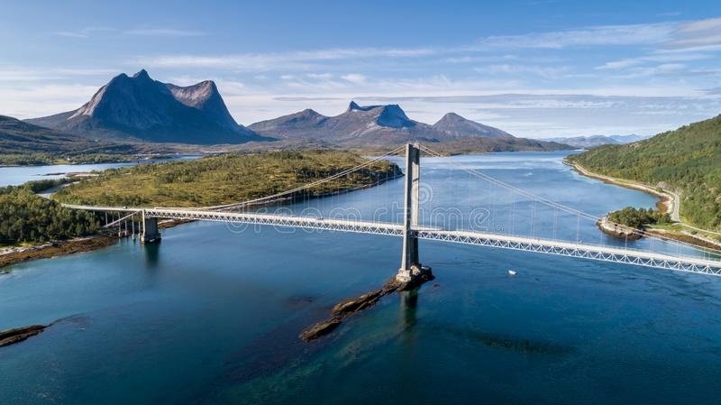 Aerial shot of a suspension bridge over Efjord with mountain Stortinden in the background. Ballangen, Norway royalty free stock images