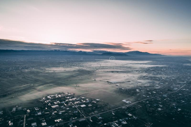 Aerial shot of a town. Aerial drone shot of a small town with clouds stock images