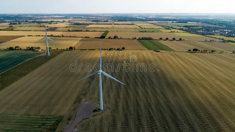 Aerial Shot of Windfarm. With Agricultural Surroundings stock image