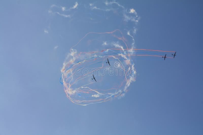 Aerial show of a group of acrobatic gliders stock photos
