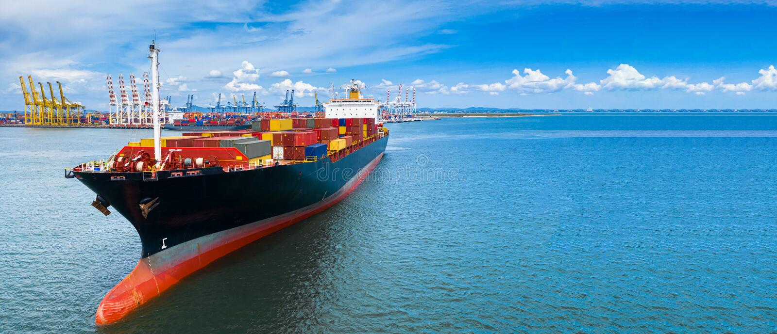 Aerial side view container ship carrying container in import export business logistic and transportation of international by royalty free stock photos