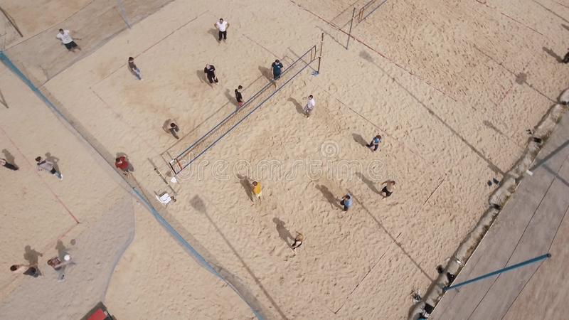 Aerial Spinning Shot People Playing Volleyball At Beach Playground Sunny Day Stock Footage
