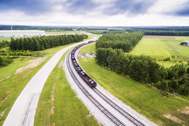 Aerial 2 - steel coils in rail cars on train tracks in Alabama. Aerial view - closer - steel coils in rail cars on train tracks in Alabama royalty free stock images