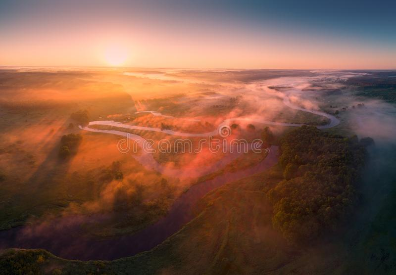 Aerial summer landscape with colorful fog in morning sunlight. River with most early in the morning. stock photography