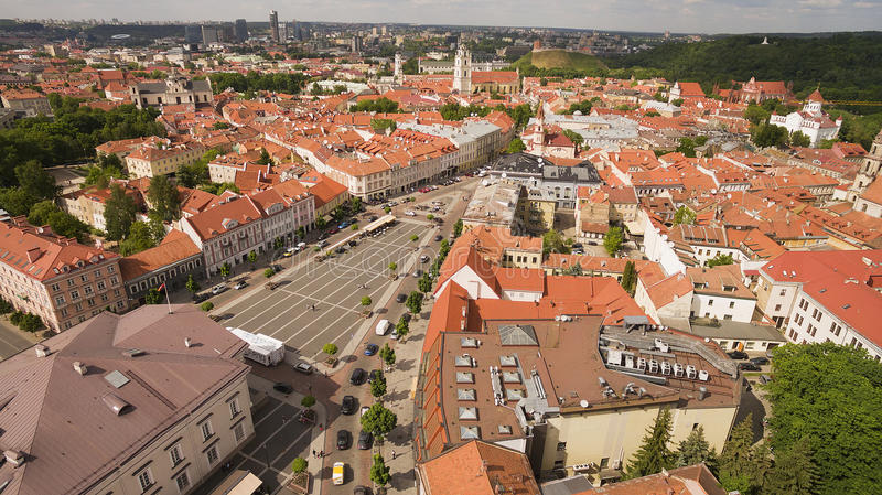 AERIAL. Sunny shot above Town Hall Square of Vilnius old. AERIAL. Sunny summer shot above Town Hall Square of Vilnius old town stock photos