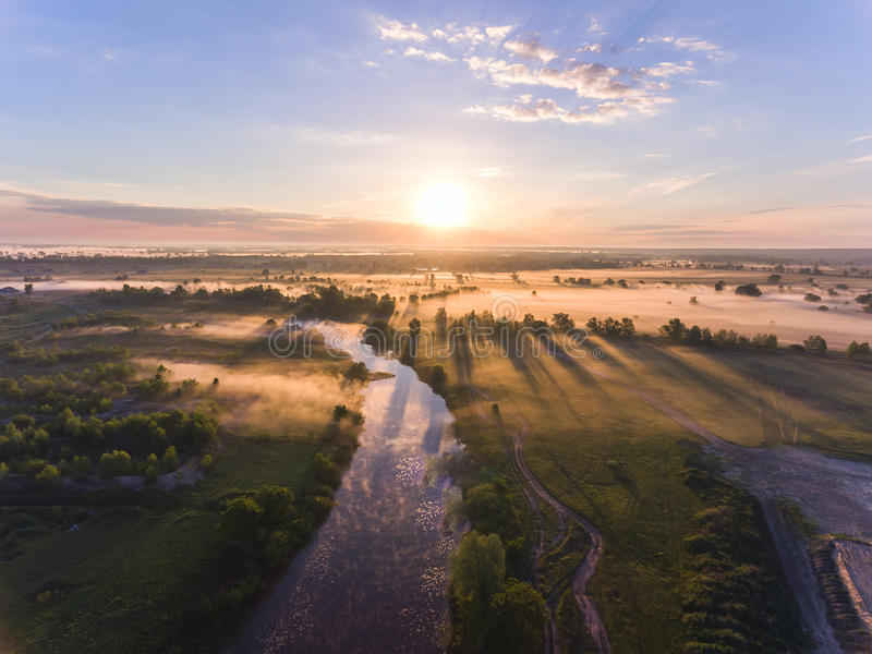 Aerial sunrise with fog at the tree tops in the rural countryside royalty free stock images