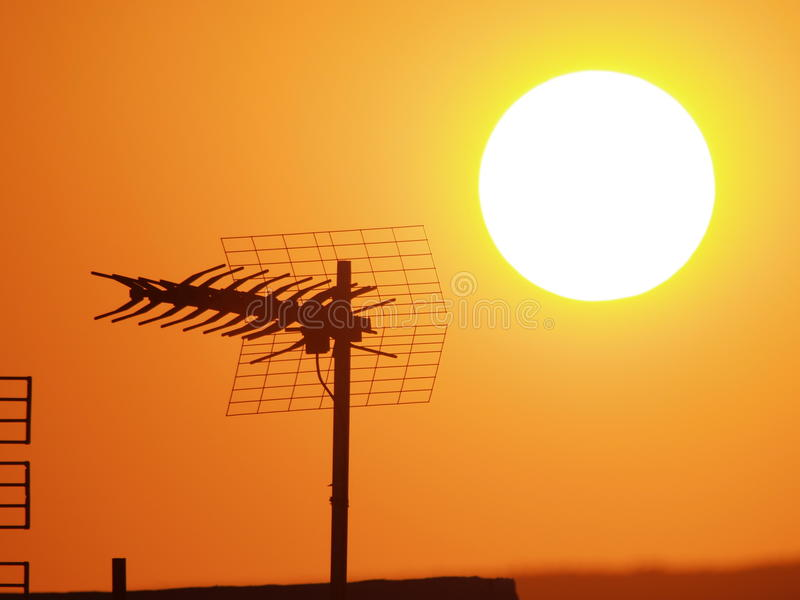Aerial at sunset. A silhouette of an aerial in front of setting sun stock images