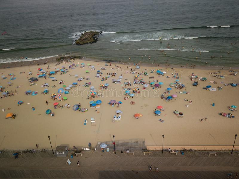Aerial of Sunset in Asbury Park Beachgoers royalty free stock photography