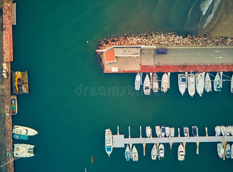 Aerial sunset view of the marina of La Pobla de Farnals, Valencia, Spain. Boats moored in the harbor at sunset of the stock photography