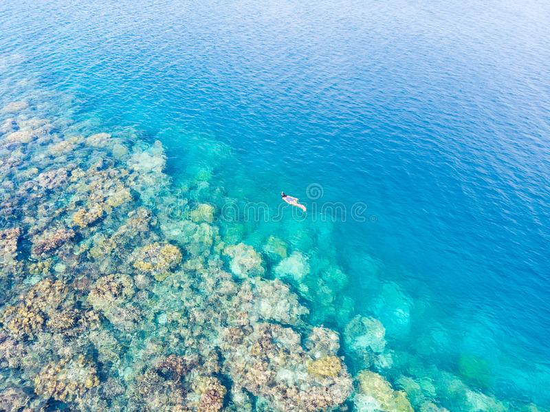 Aerial top down people snorkeling on coral reef tropical caribbean sea, turquoise blue water. Indonesia Banyak Islands Sumatra, royalty free stock photography