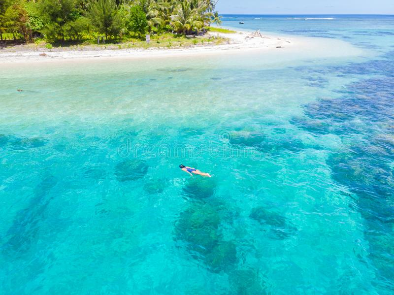 Aerial top down people snorkeling on coral reef tropical caribbean sea, turquoise blue water. Indonesia Banyak Islands Sumatra, royalty free stock image