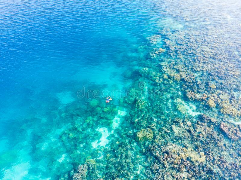 Aerial top down people snorkeling on coral reef tropical caribbean sea, turquoise blue water. Indonesia Banyak Islands Sumatra, royalty free stock images
