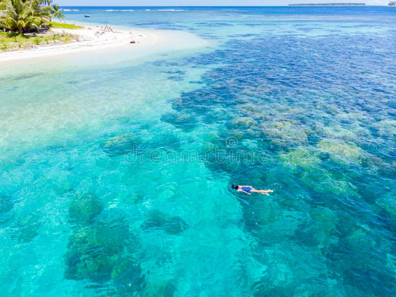Aerial top down people snorkeling on coral reef tropical caribbean sea, turquoise blue water. Indonesia Banyak Islands Sumatra, stock image