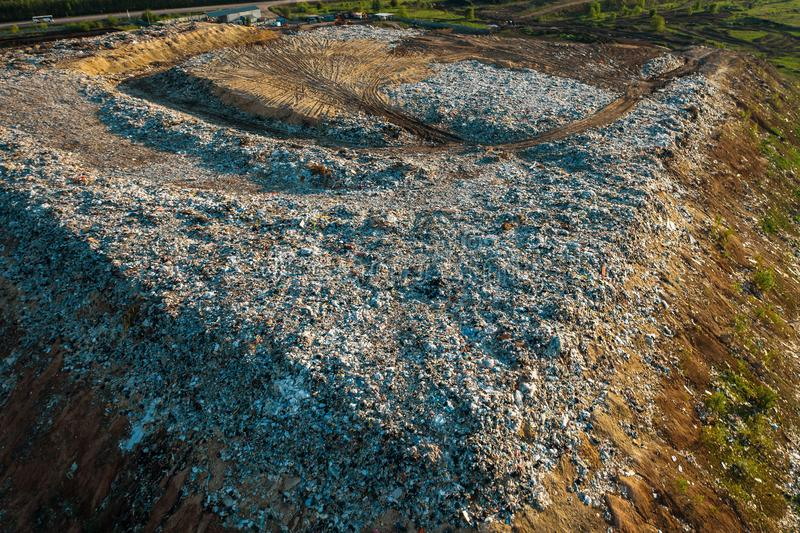 Aerial top down view of city garbage dump. Pile of plastic trash, food waste, landfill royalty free stock images