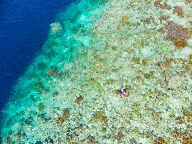 Aerial top down view coral reef tropical caribbean sea, turquoise blue water. Indonesia Moluccas archipelago, Banda Islands, Pulau stock image