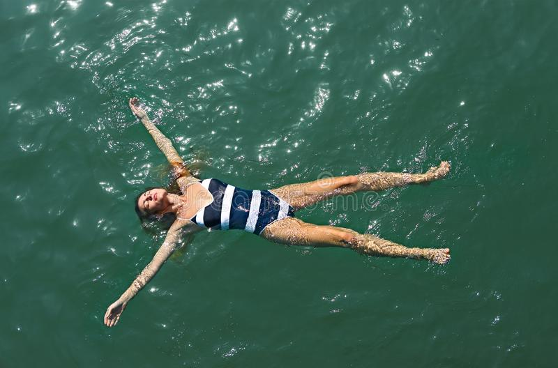 Aerial top down view of a girl in the sea royalty free stock image