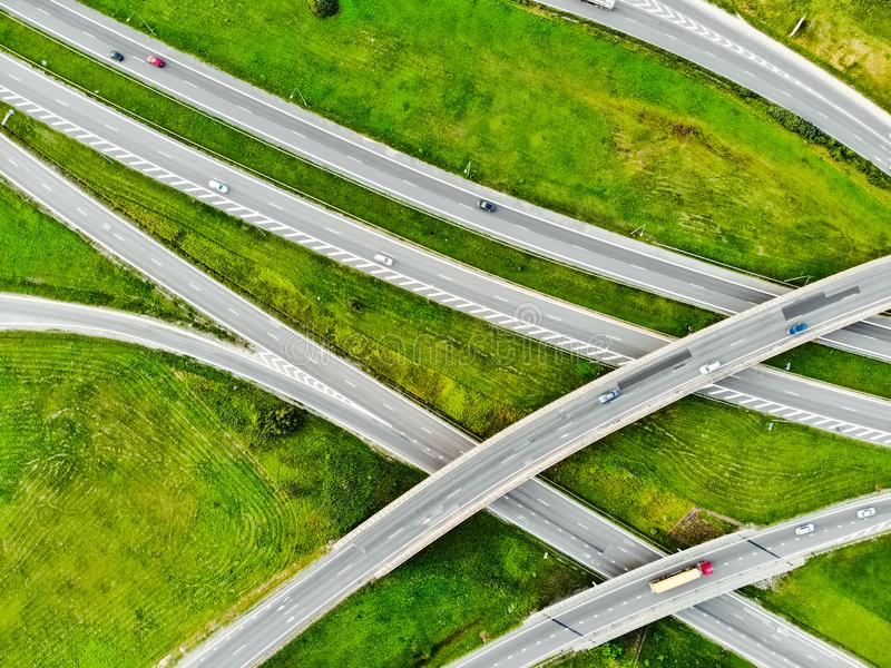 Aerial top down view of a highway road intersection. Cars passing, highway junction, cross roads royalty free stock image
