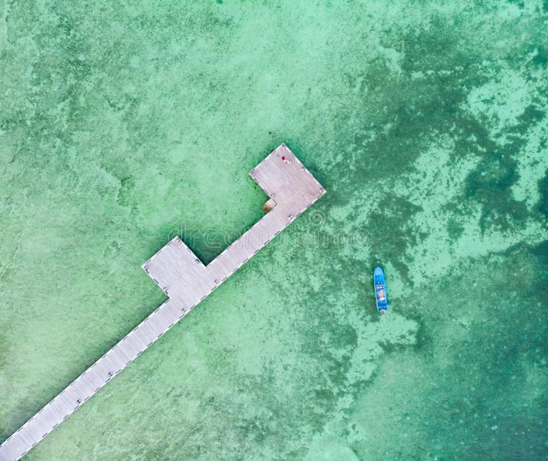 Aerial top down view tropical beach pier caribbean sea at Pasir Panjang. Indonesia Moluccas archipelago, Kei Islands royalty free stock photo