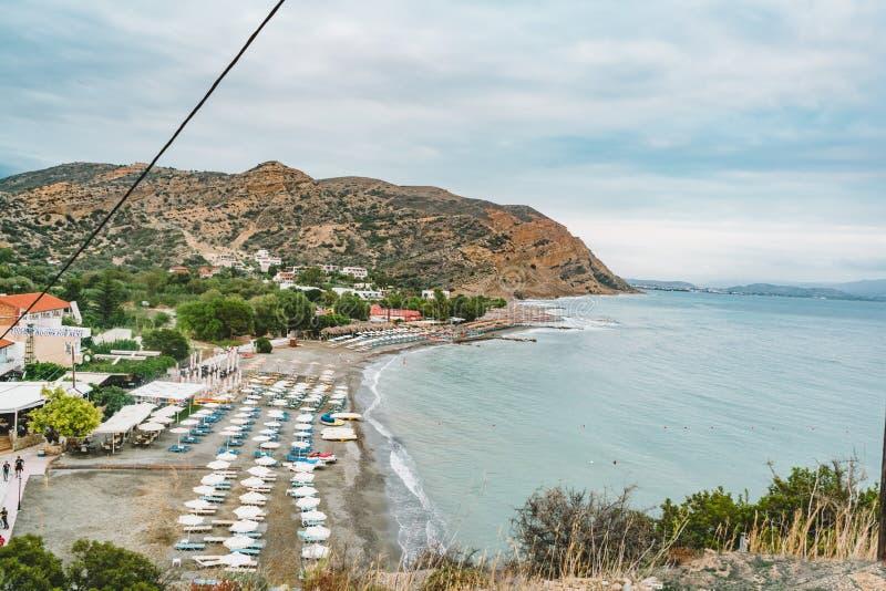 Aerial Top Panorama view of Aghia Galini beach at Crete island in Greece. South coast of the Libyan sea. stock photo