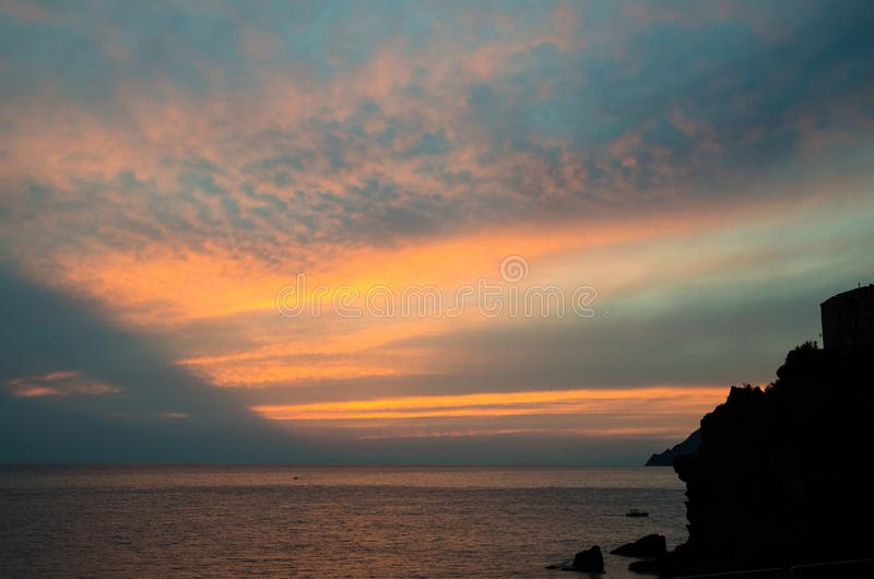 Aerial top panoramic view of horizon with dramatic sky at sunset dusk, Gulf of Genoa, Ligurian Sea, coastline of Riviera di Levant. E, National park Cinque Terre royalty free stock photo